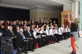 Caz conducting full choirs at shopping centre