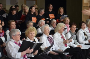 Full choirs with WG women in front